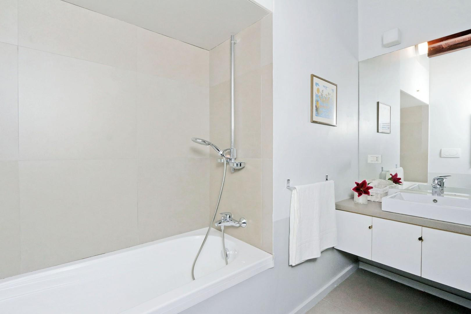 All 3 en suite bathrooms are modern and comfortable, with a shower or tub and heated towel racks.
