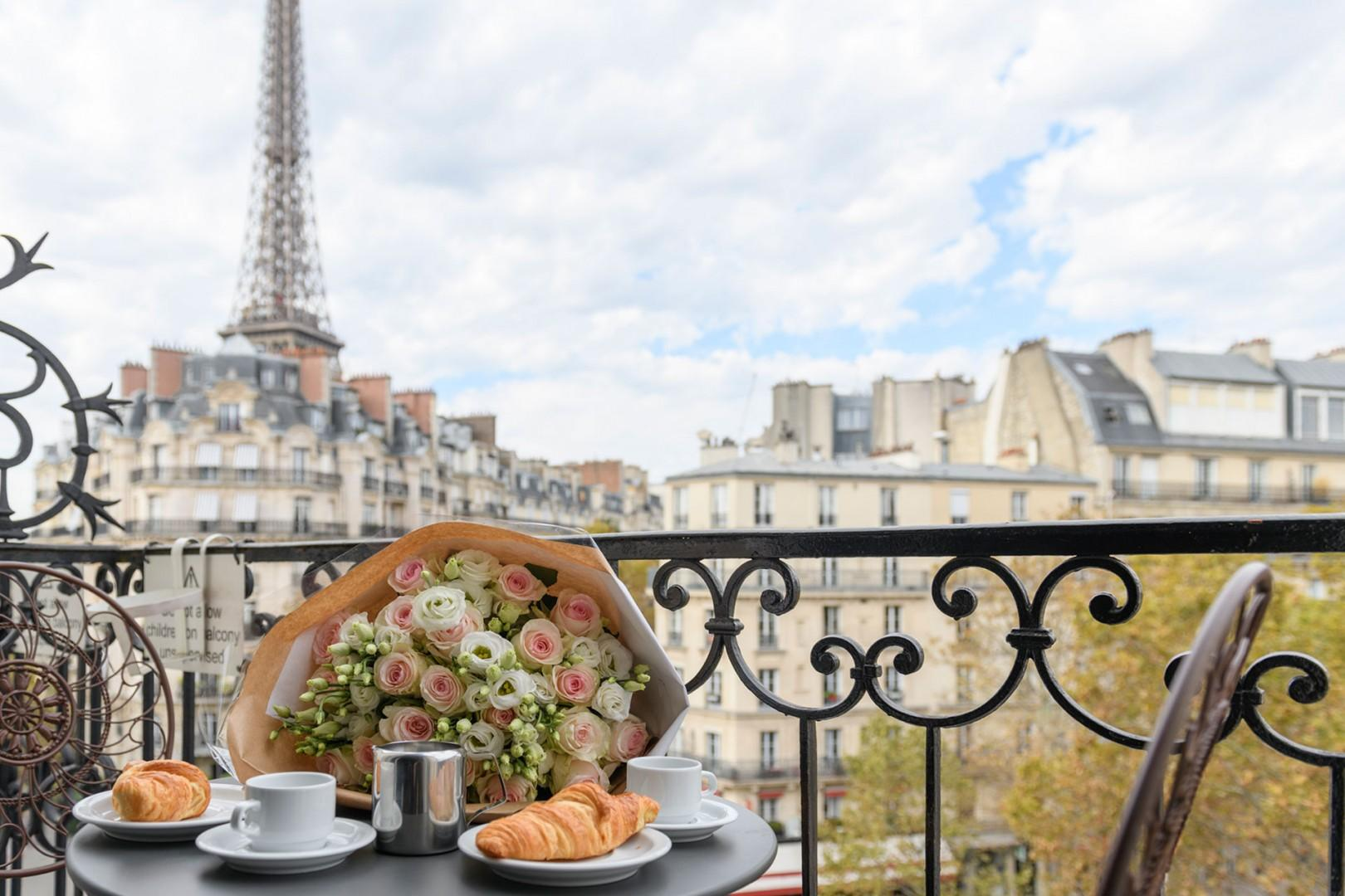 Have an al fresco breakfast on your balcony with stunning Eiffel Tower views!