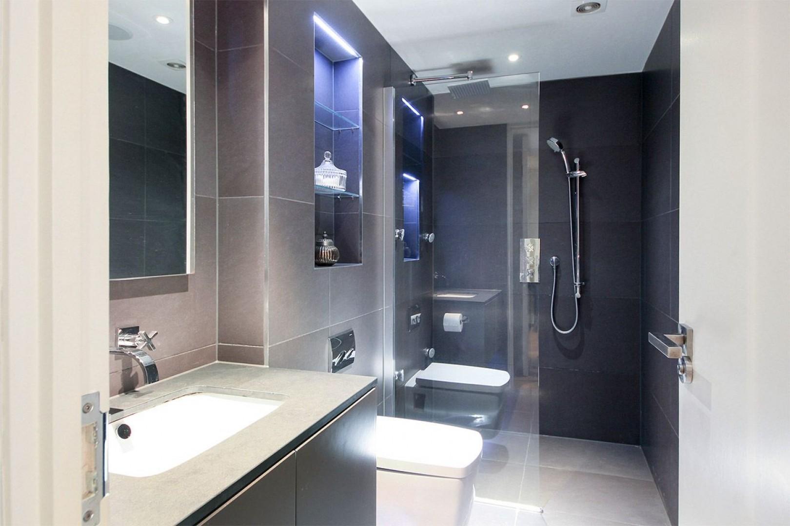 En suite bathroom with large walk-in shower, sink and toilet