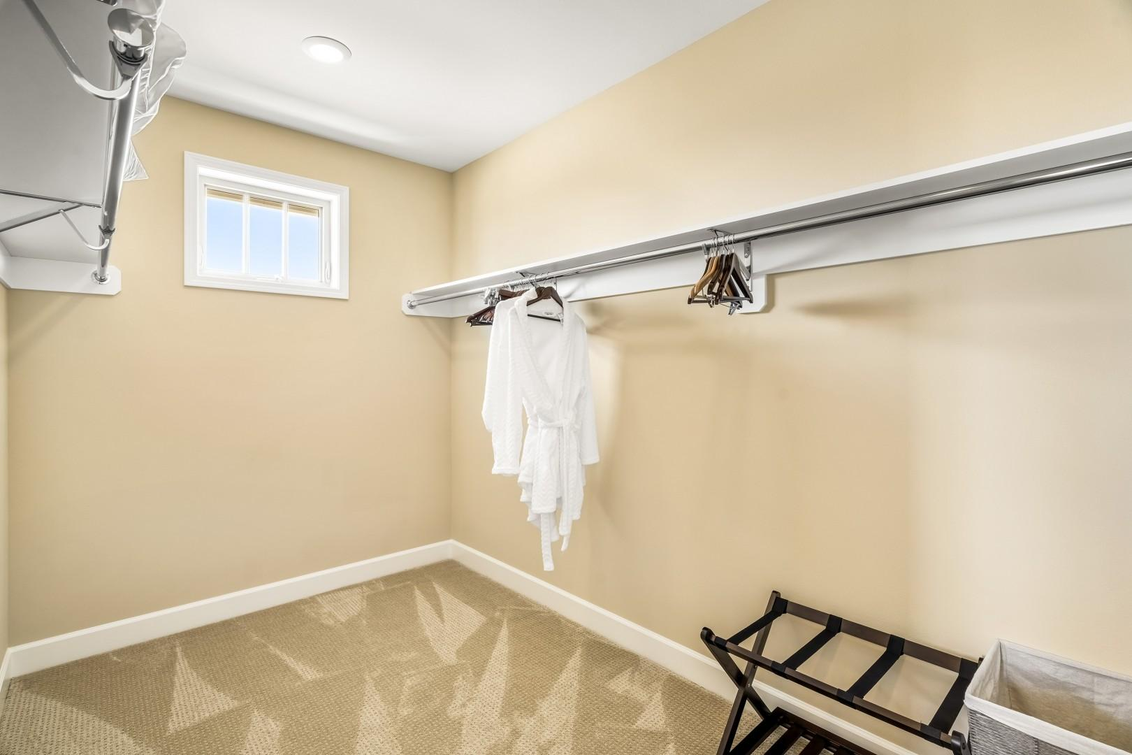 Master bedroom closet with robes!
