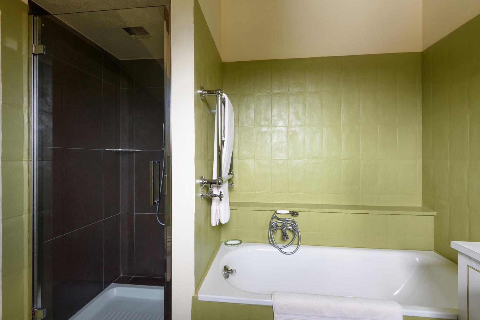En suite bathroom with bedroom 4 has bathtub and separate shower.