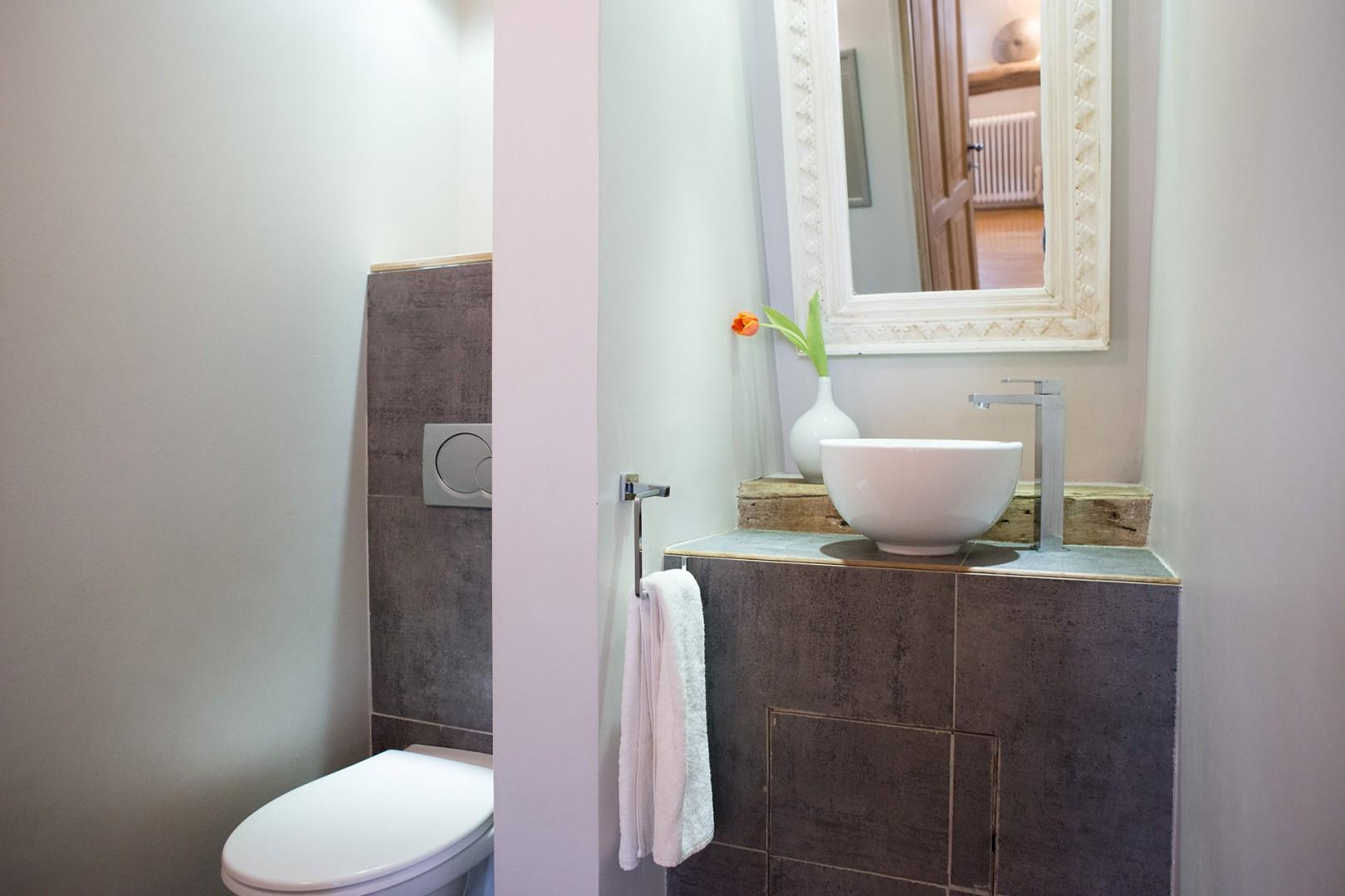 Next to the kitchen on the lower level is a lovely half bath.