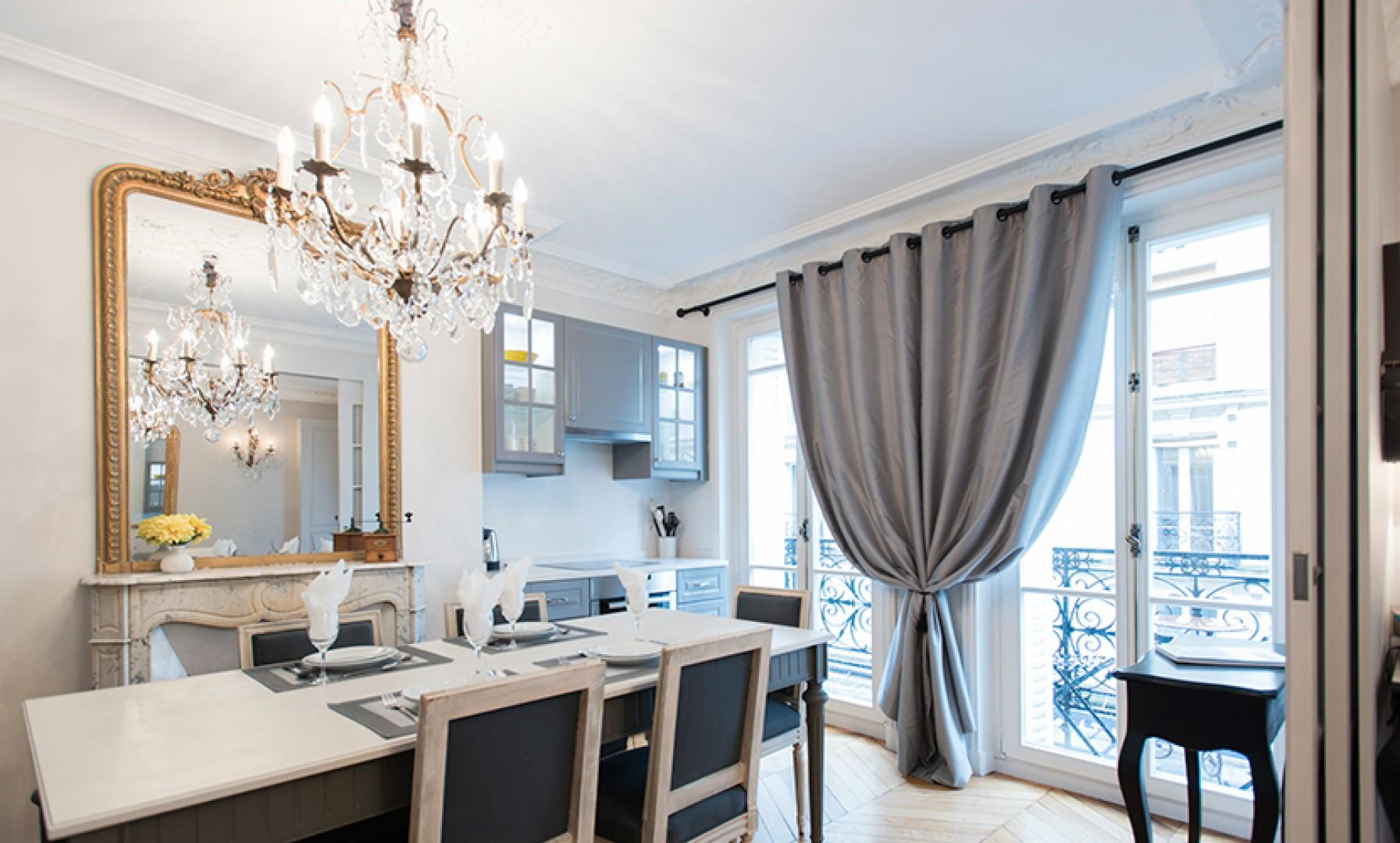 Large French doors fill the kitchen and dining area with light.
