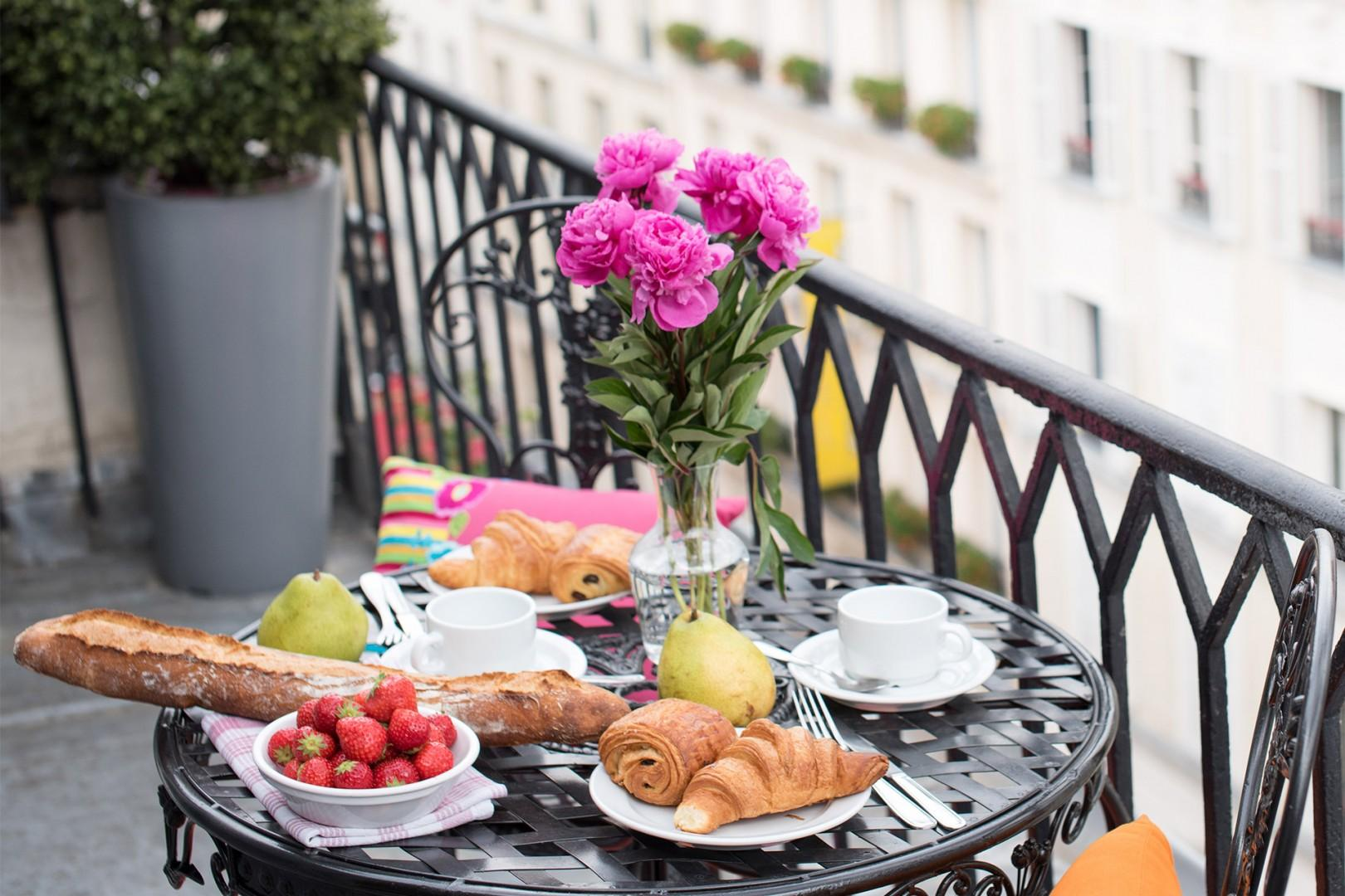 You will love the extra-wide balcony with an iron bench, bistro table and views!