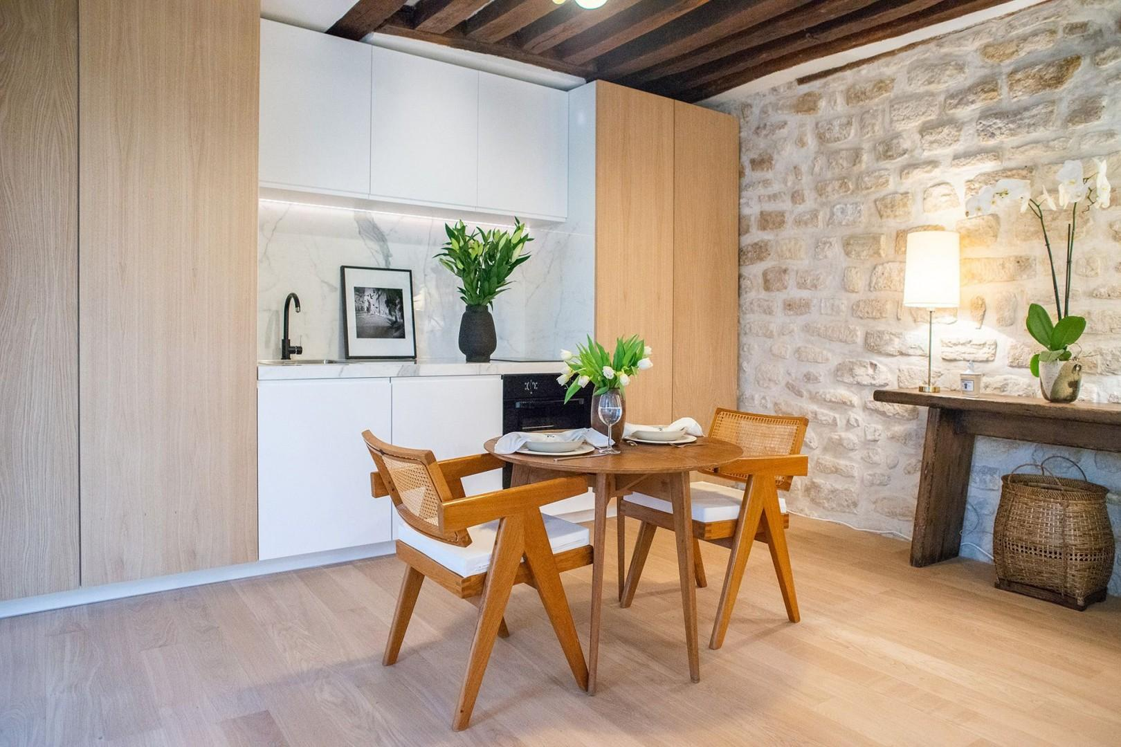 Have casual meals at home in your Parisian apartment.