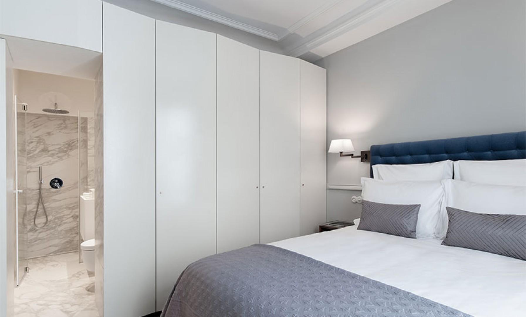 The bedroom comes with an en suite bathroom.