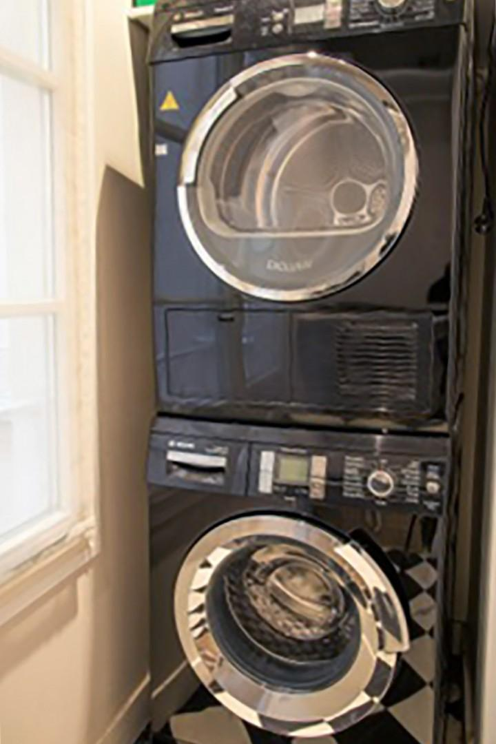 A separate washer and dryer is located in the laundry room.