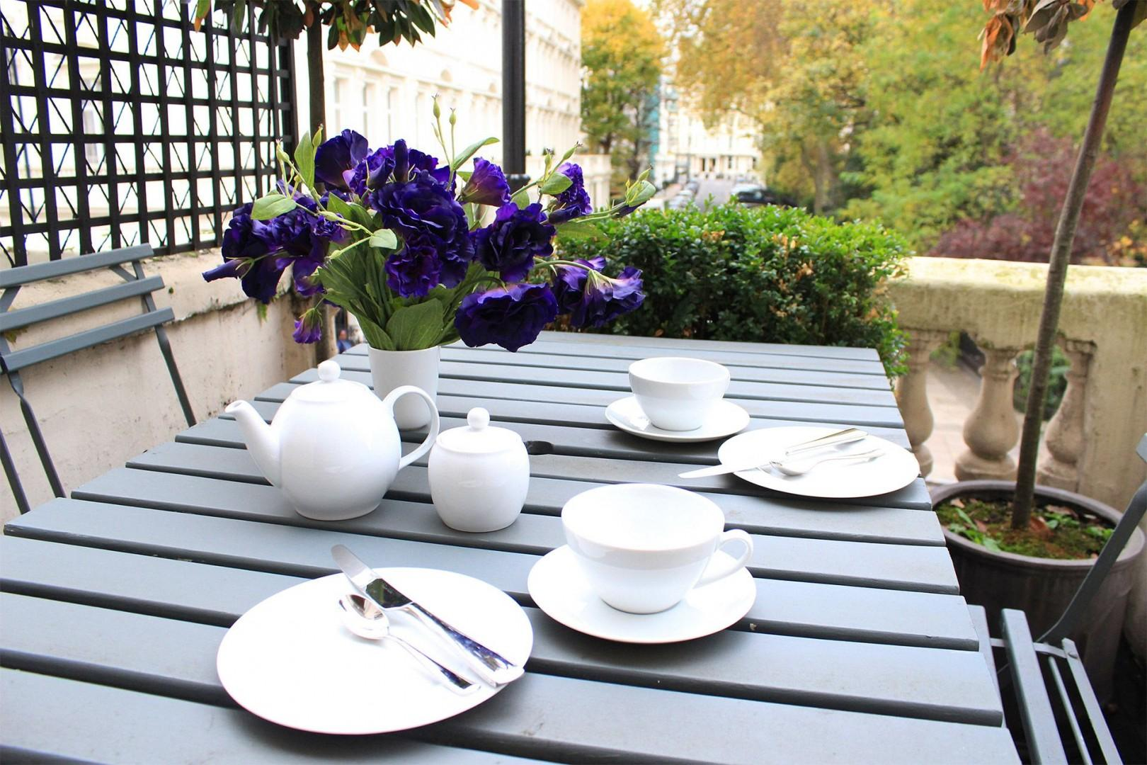 Set the balcony table for afternoon tea