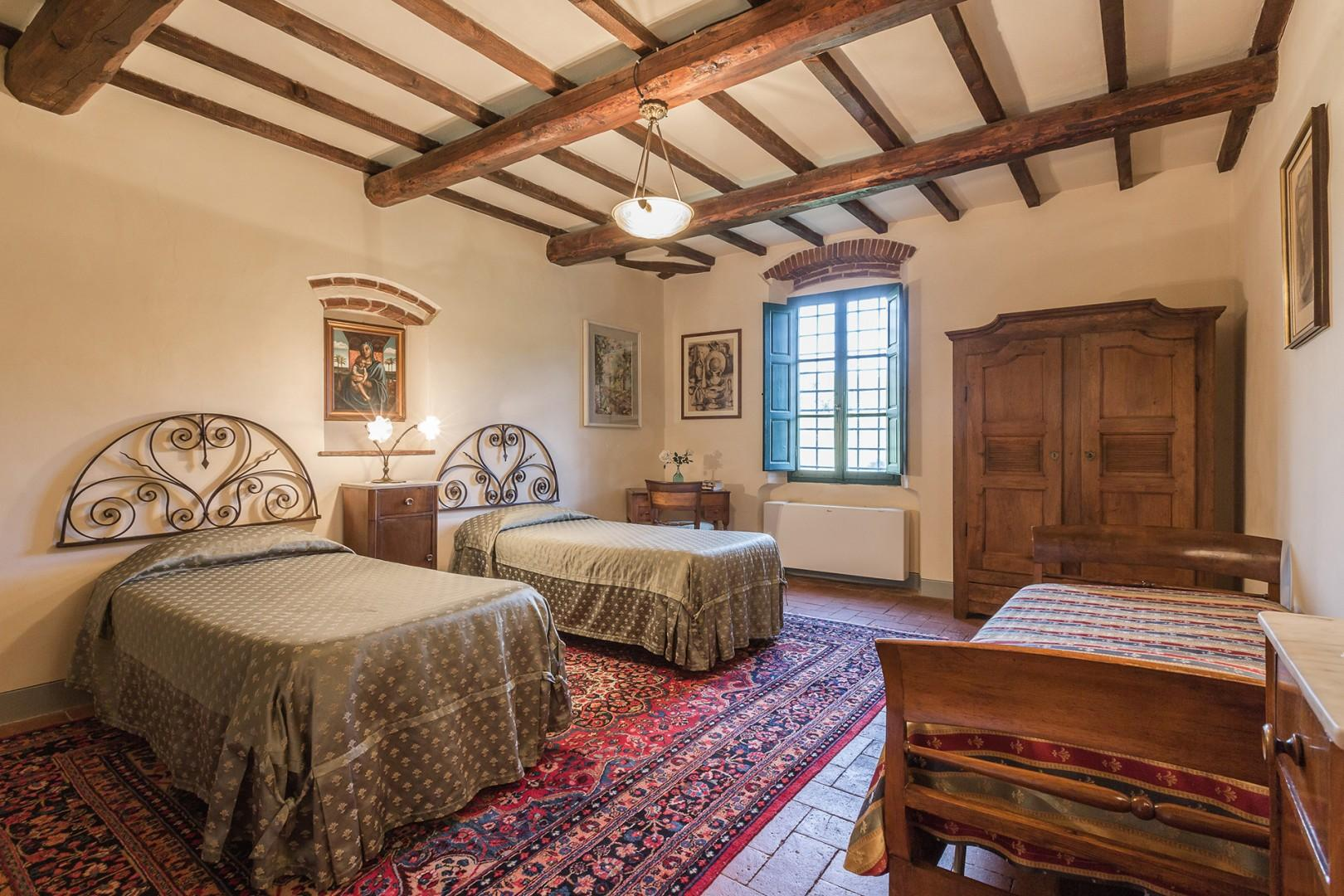 Bedroom 5 has three beds. The wardrobe, bedside table and bureau date from the 1700s.