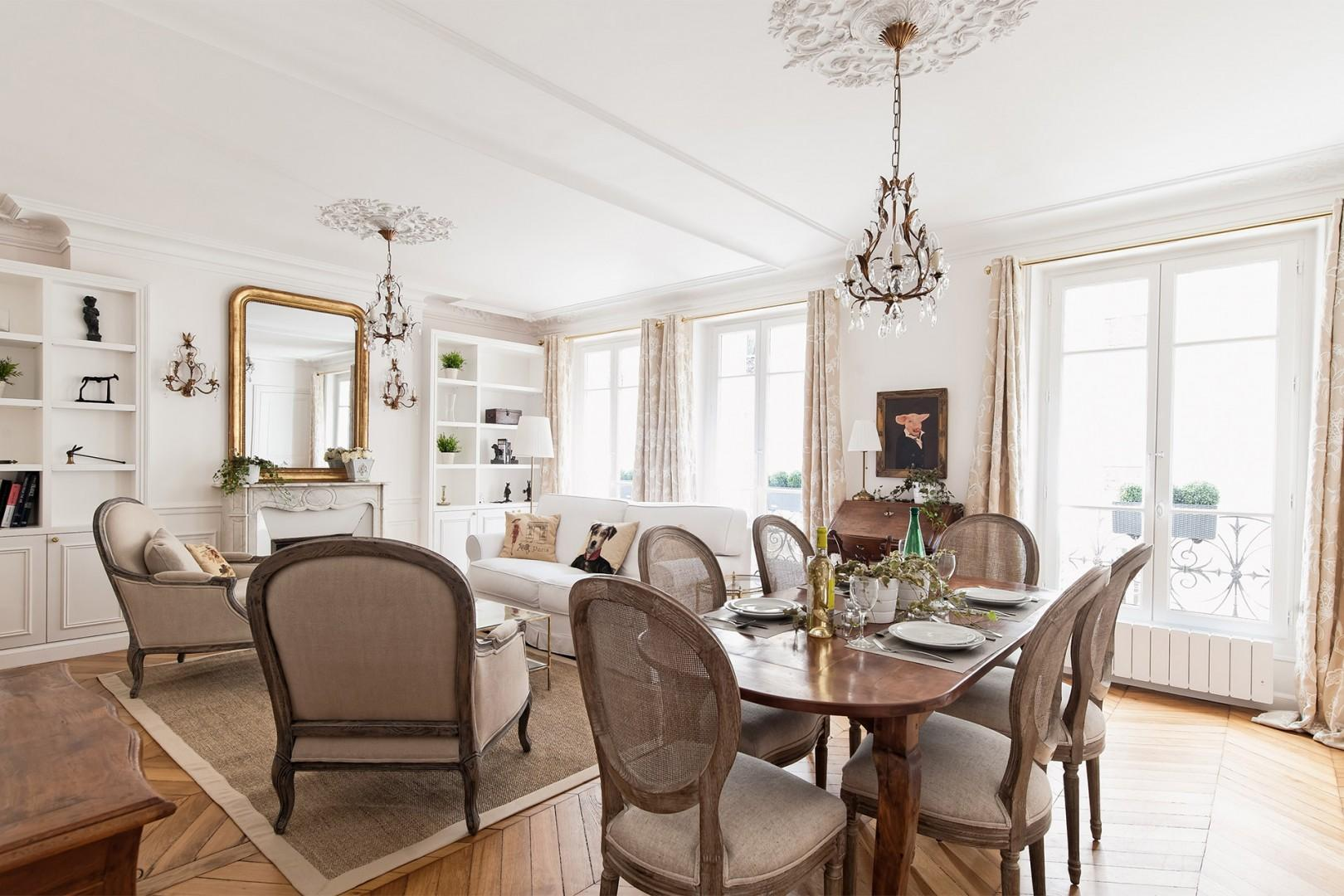 Wooden furnishings and crystal chandeliers adorn the stylish space.