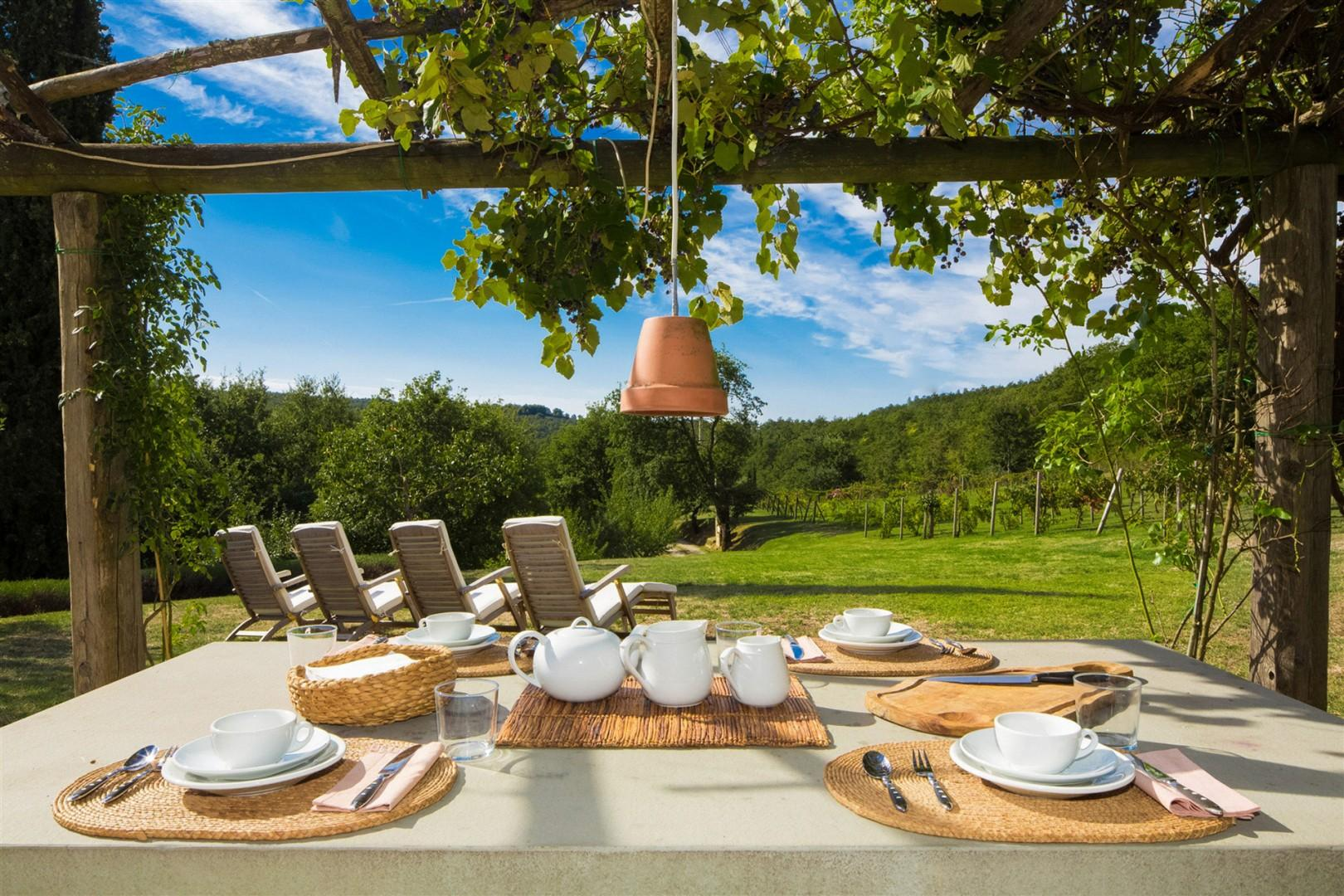 Breakfast outside on the terrace is a great way to start the day. The table seats up to 14 people.