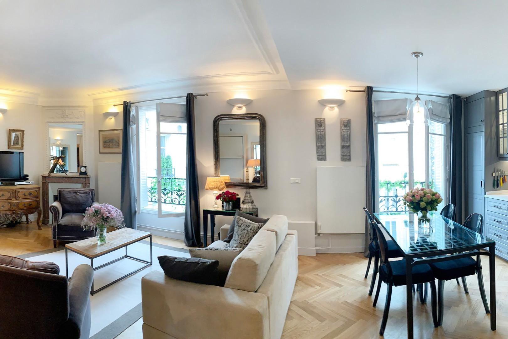 The living room is decorated in a distinctively Parisian style that guests love.