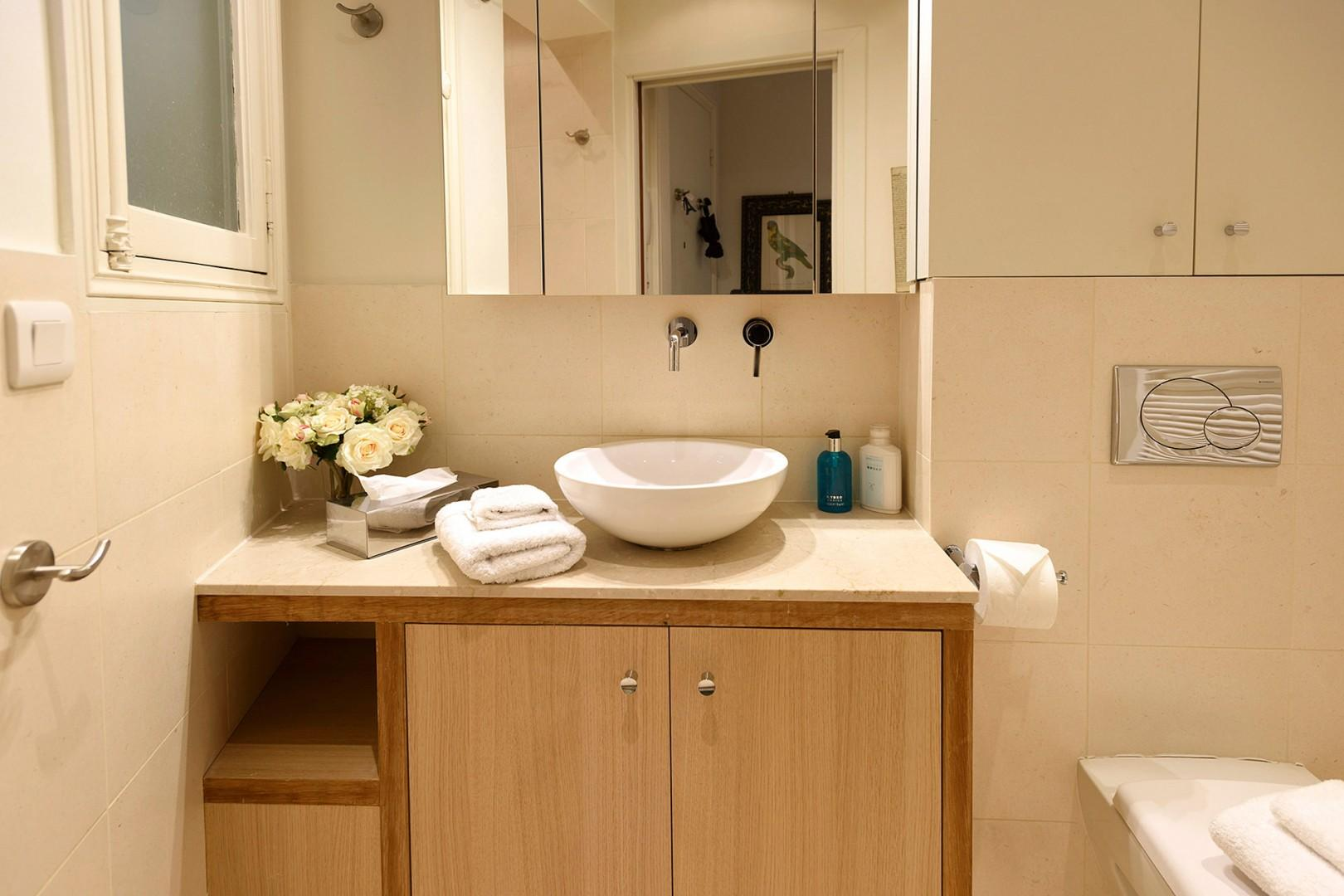 Pamper yourself in the beautiful modern bathroom.
