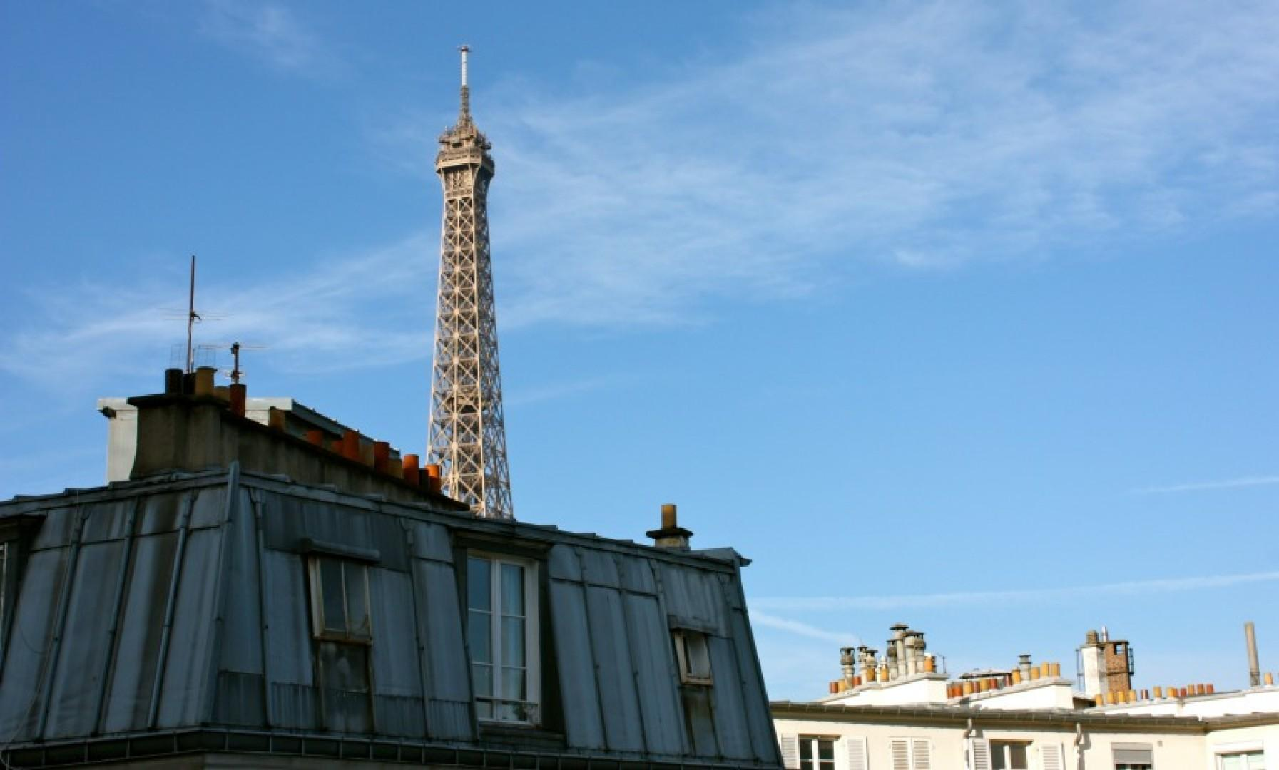 The incredible view across the rooftops to the Eiffel Tower is yours!