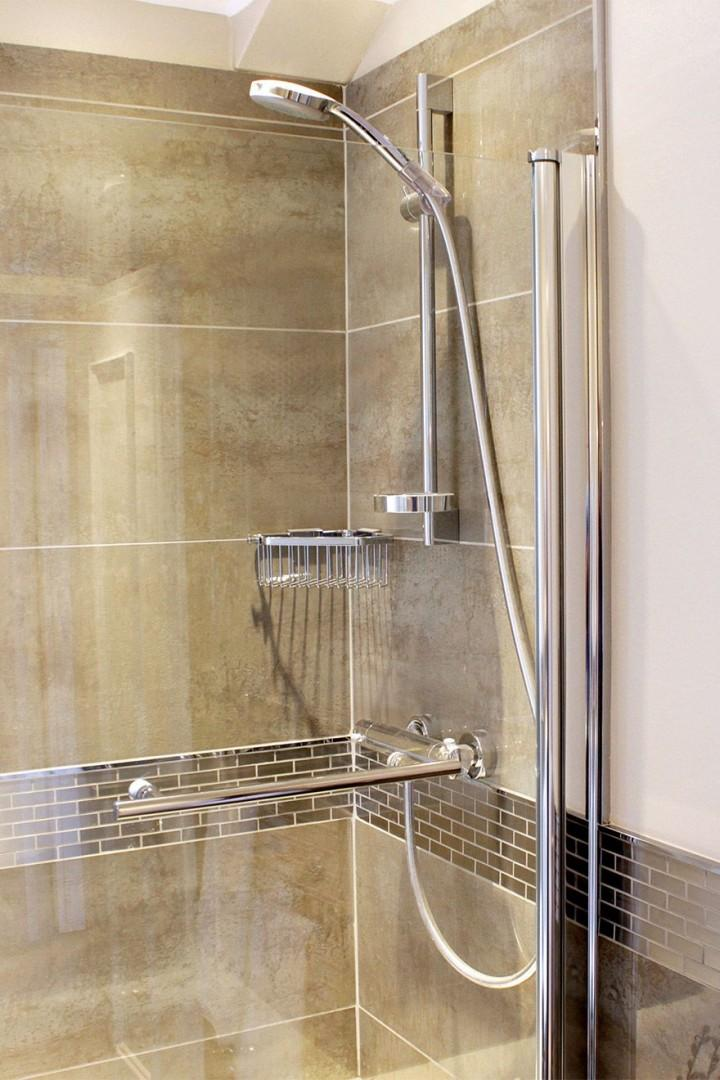 Shower over bathtub with a glass partition