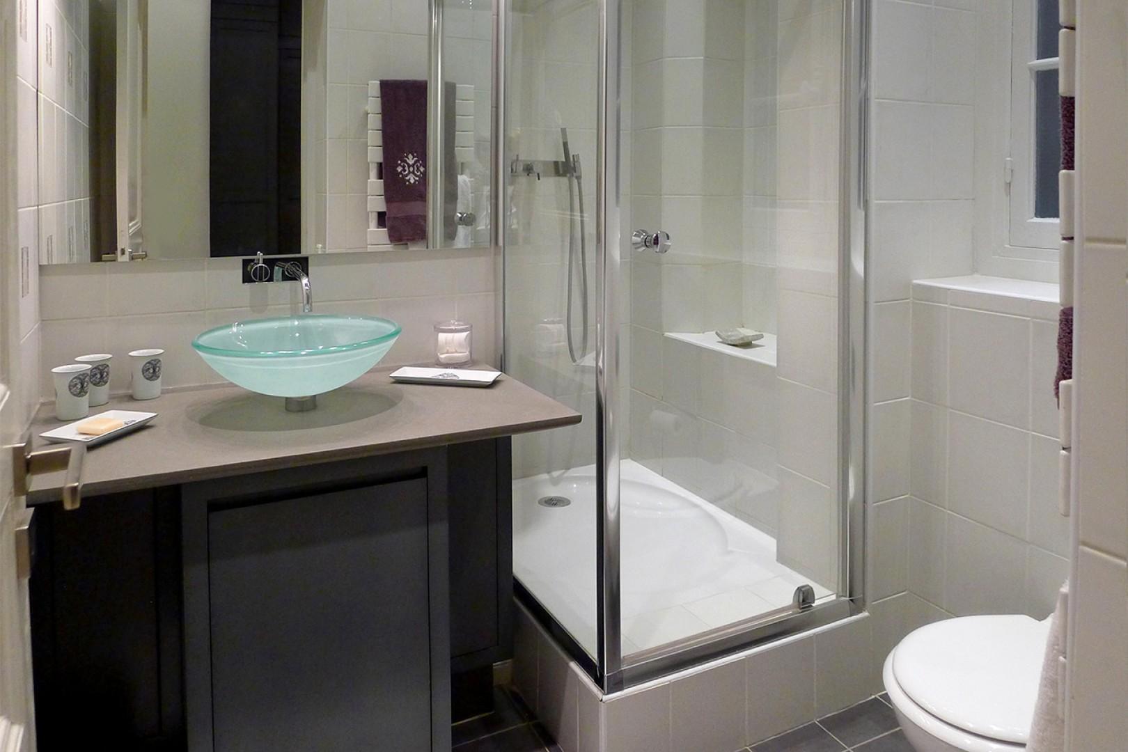 En suite bathroom 3 features a shower, toilet and sink.