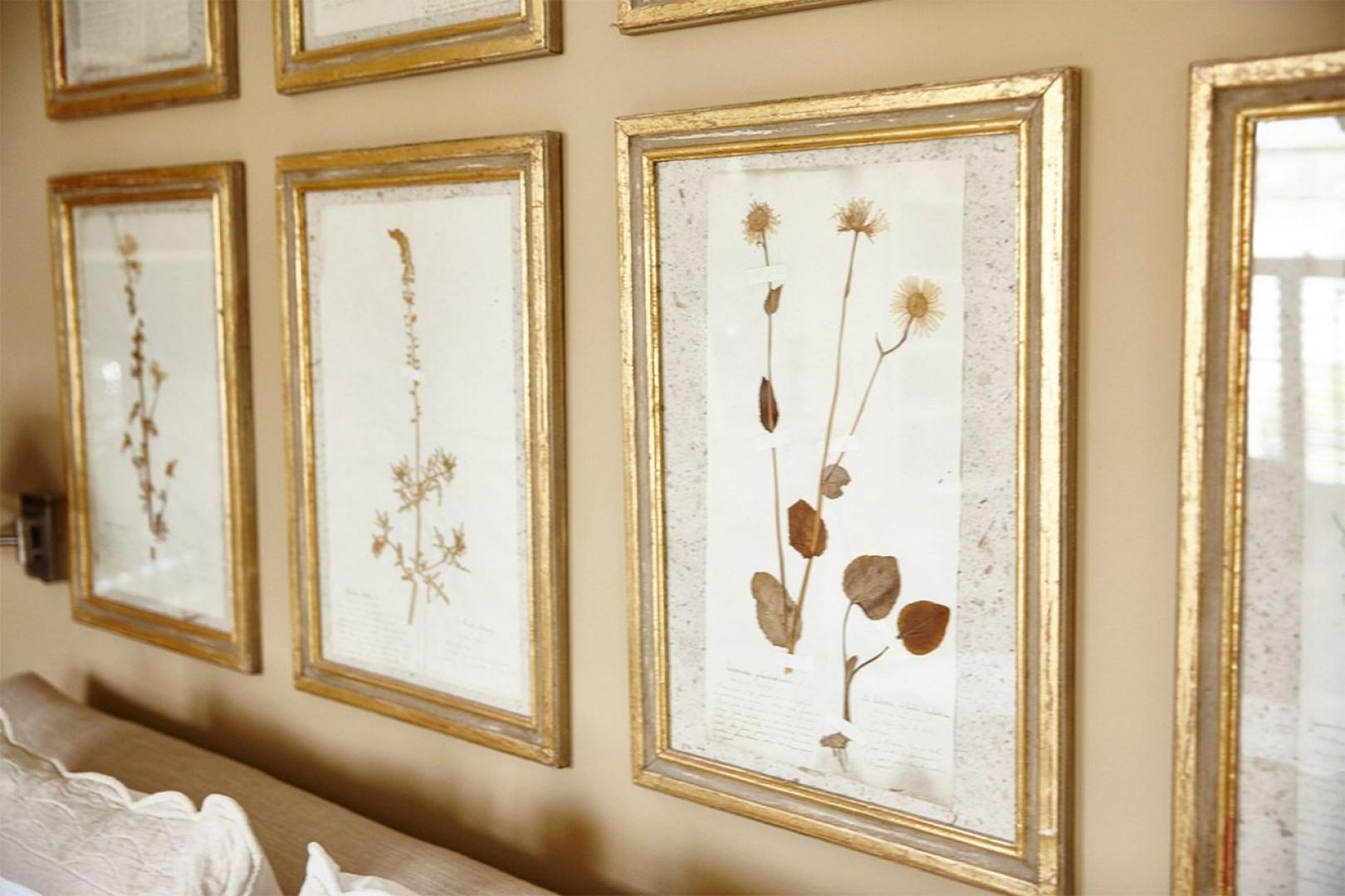 Framed pressed flowers above the bed