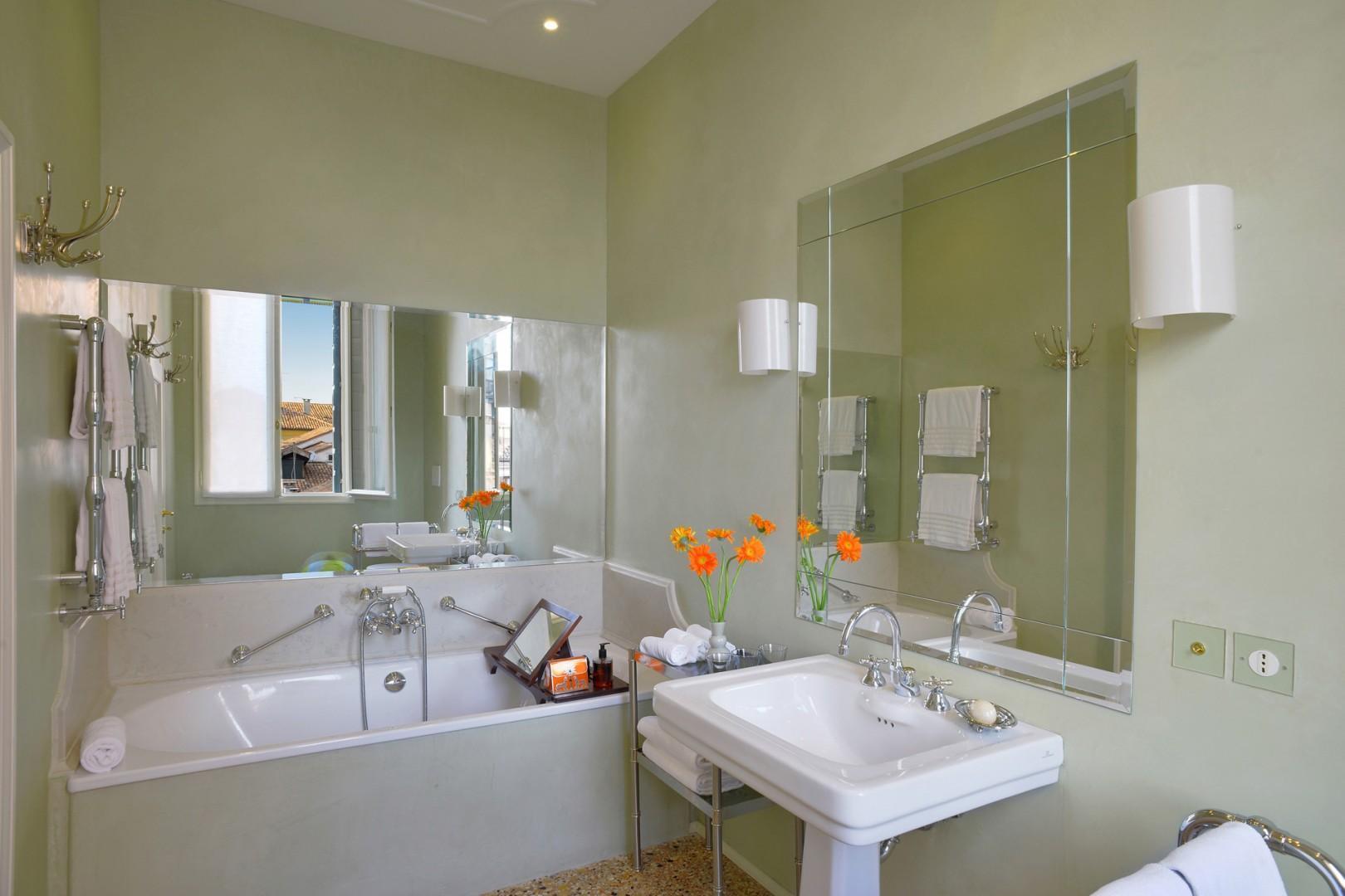 En suite bathroom for bedroom 1 with bathtub and handheld showerhead.