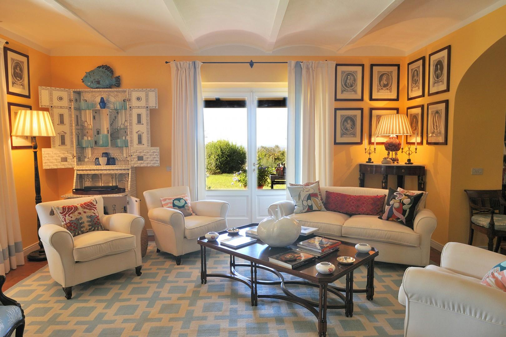 Second living room with large French doors leading to the loggia.