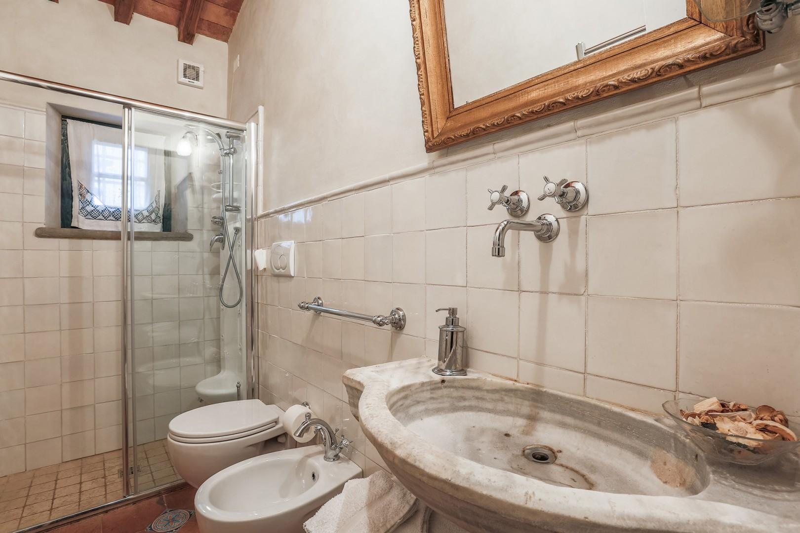 First floor bathroom 3 has large shower.