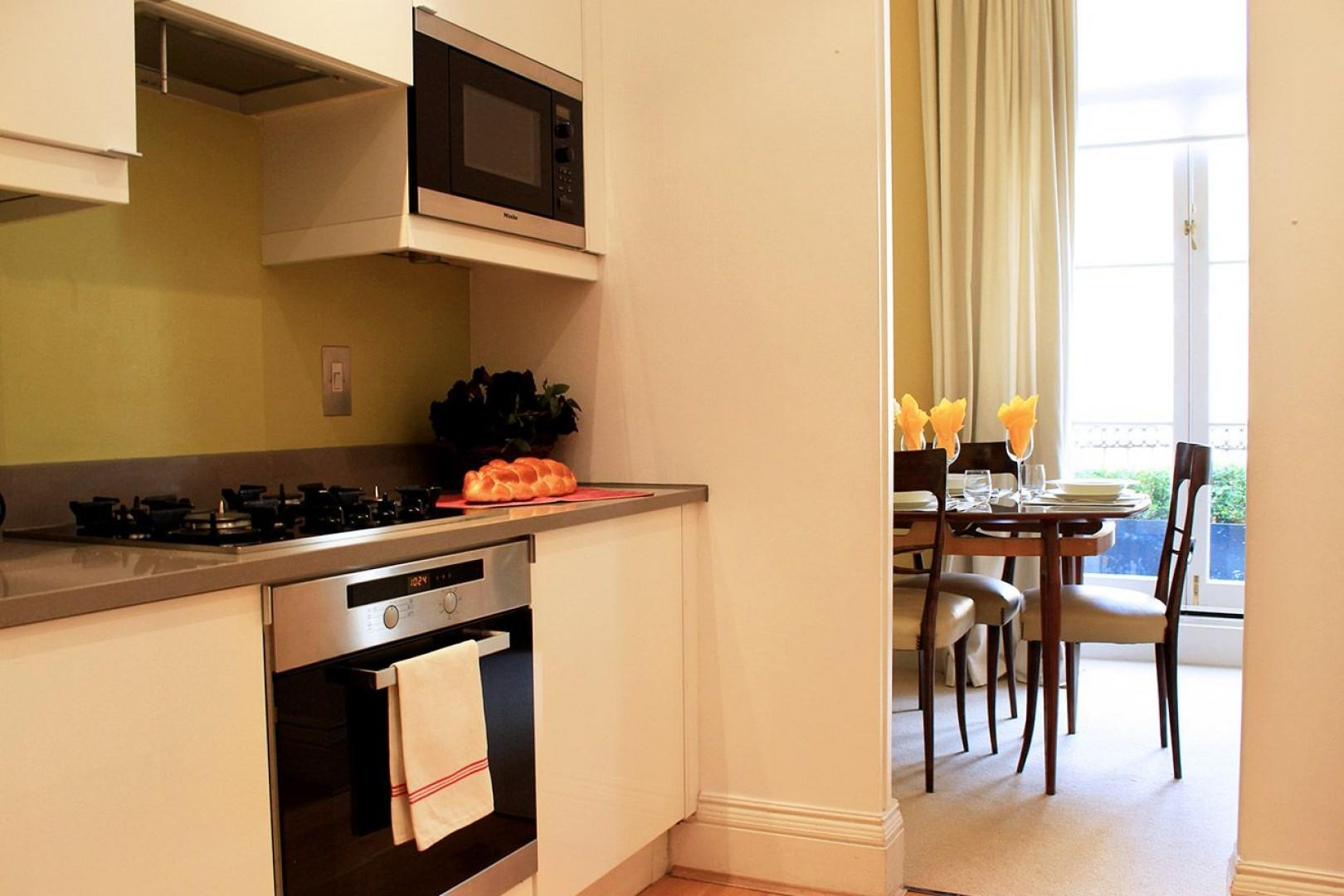 Designer kitchen with oven and separate microwave