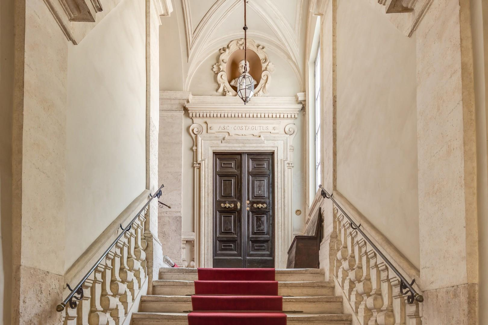 Beautiful formal staircase leading you to your apartment.