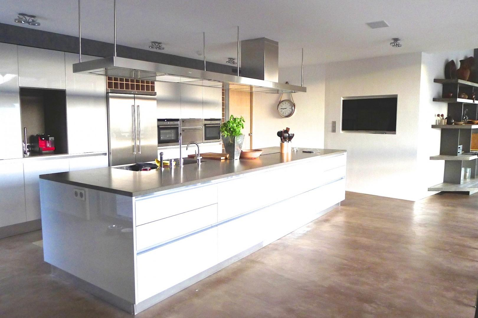 Two kitchen areas are fully equipped for all culinary needs