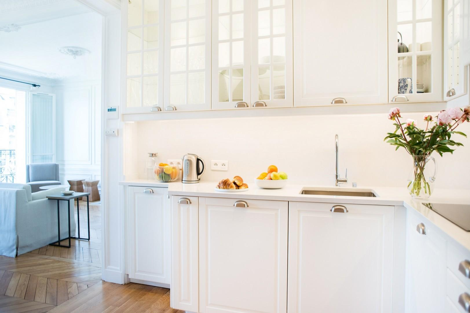 The kitchen separates common areas and private bedrooms.