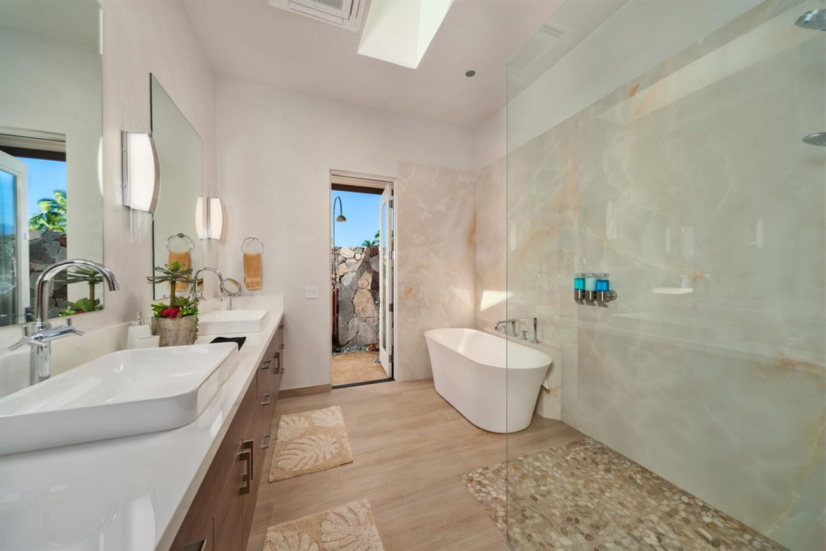 Master Suite 1 bath with elegant soaking tub, dual vanity, walk-in shower, and outdoor shower.