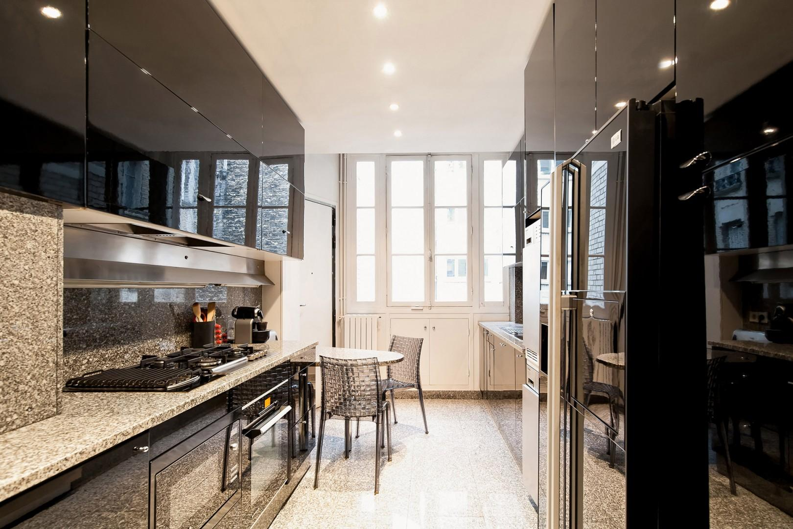 The stunning kitchen is a gourmand's dream with top-of-the-line appliances and a breakfast nook.