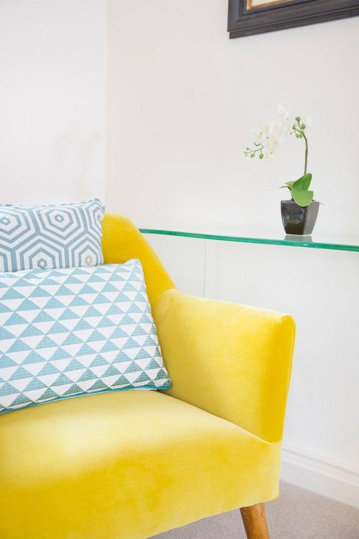 Fun yellow and blue colors liven up the living room