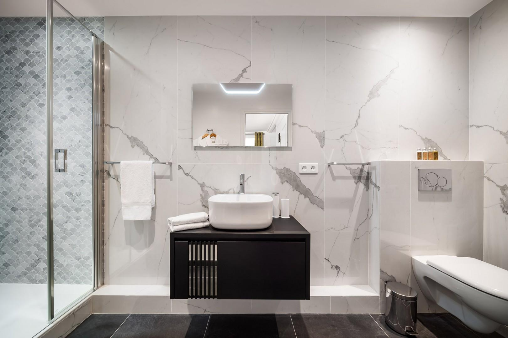 The stunning bathroom 2 is as chic as the rest of the apartment!