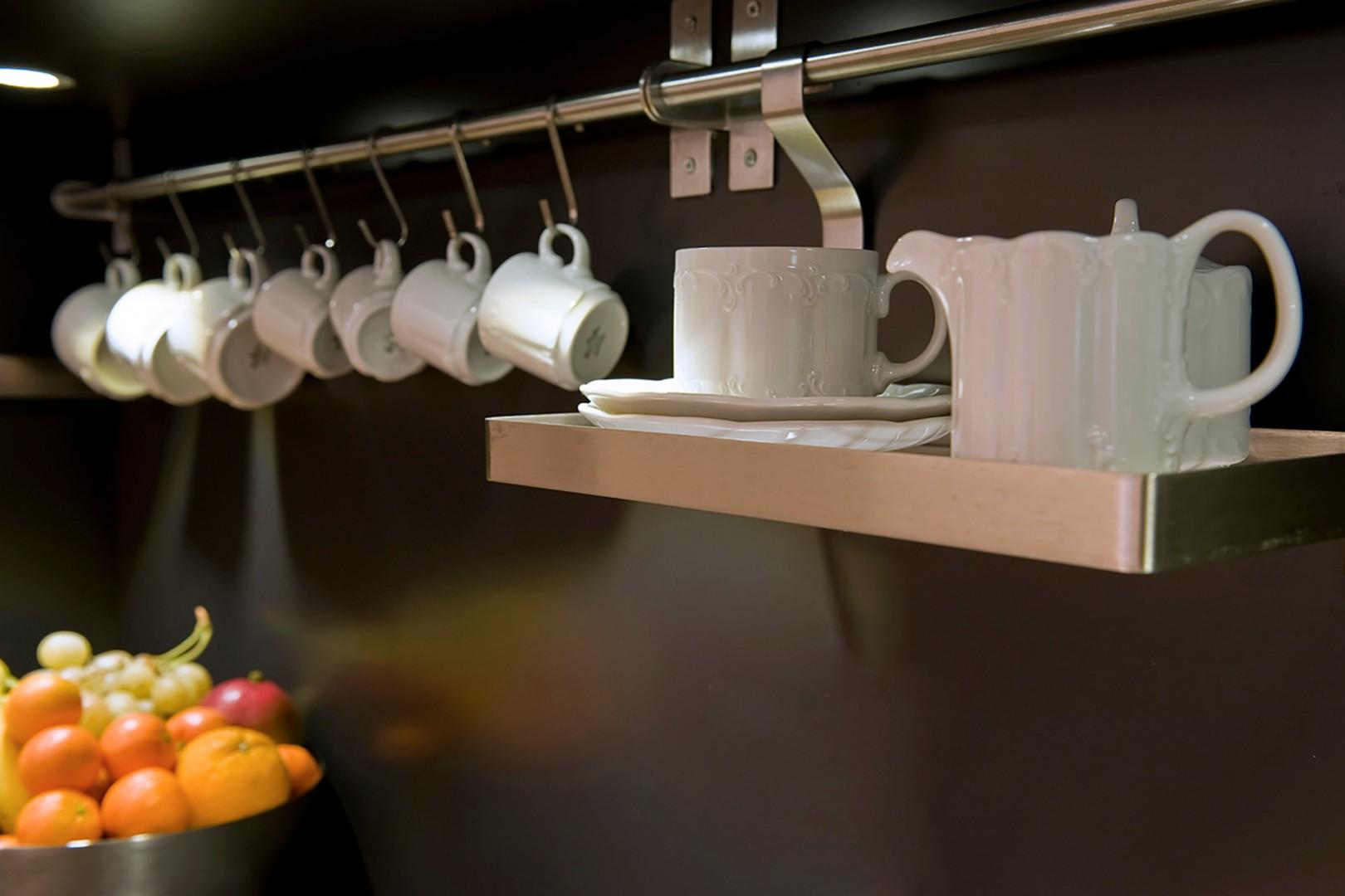Kitchen has a Nespresso machine stocked with coffee capsules.