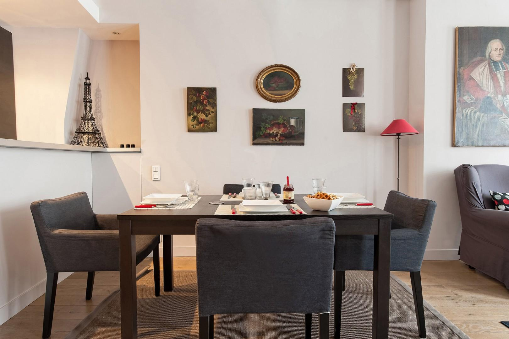 The simple and comfortable dining area seats four guests.