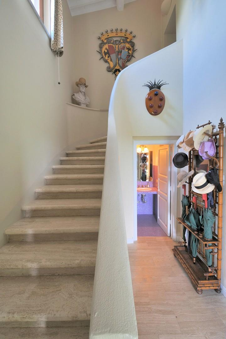 The foyer has a sweeping staircase up to the second level and a half bath.