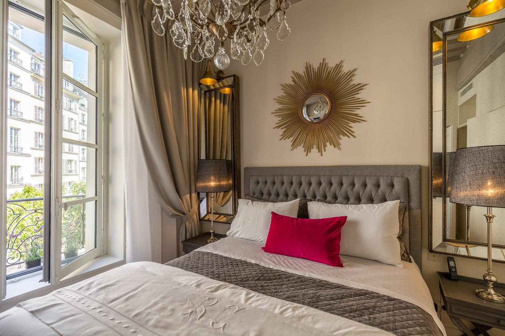 Feel at home in the beautiful bedroom with a sumptuous bed.