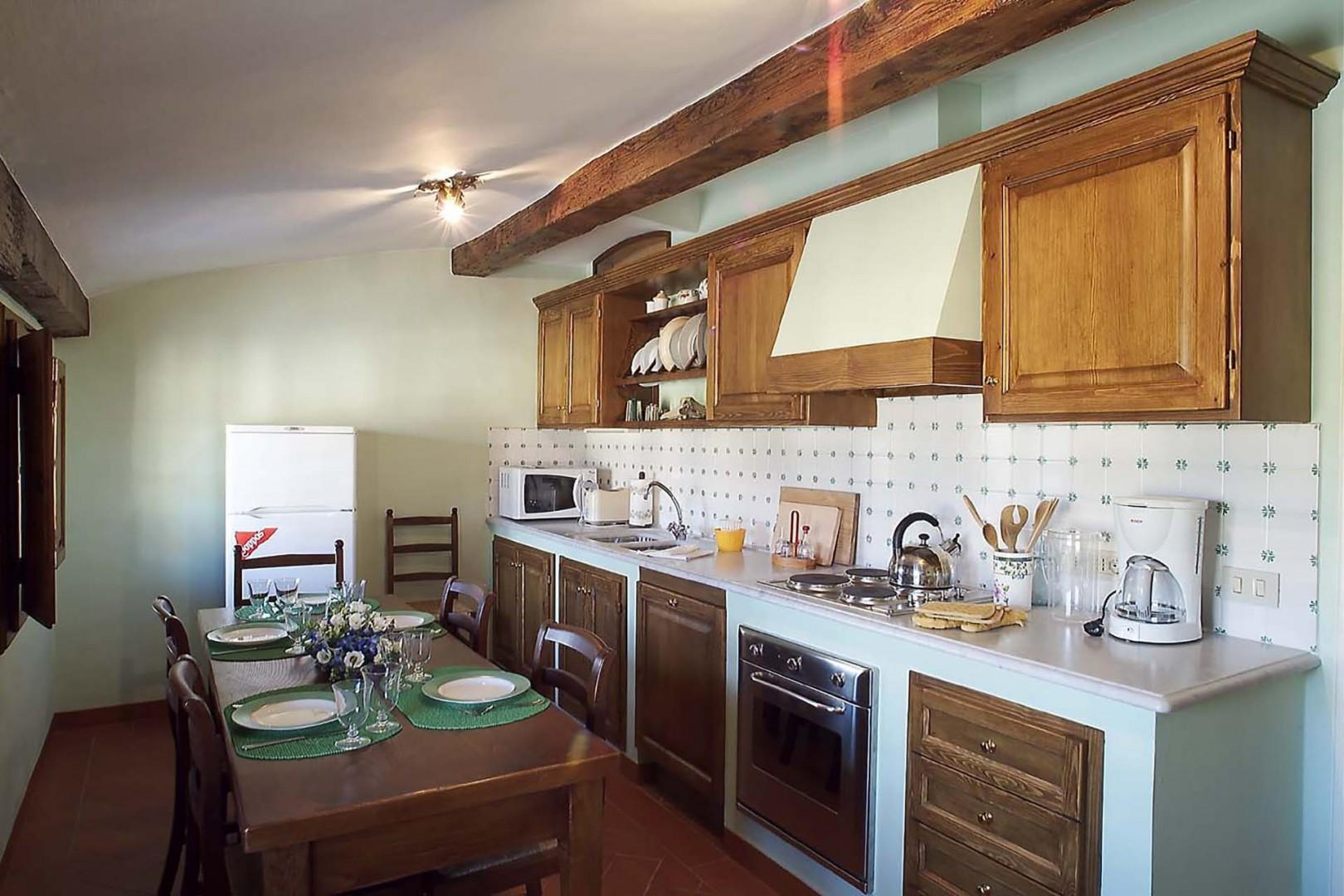 Tosca's kitchen is complete. There is room to eat in here as well as in the dining area.