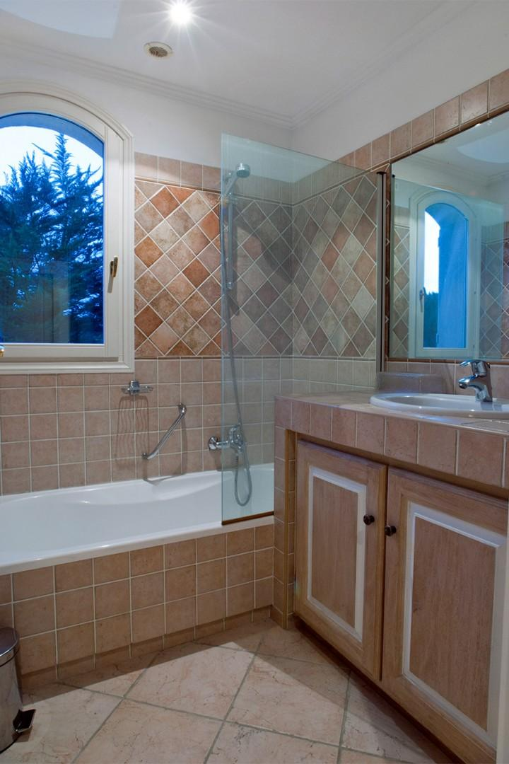 En suite bathroom to Bedroom 2 with a bath with shower fixture and sink