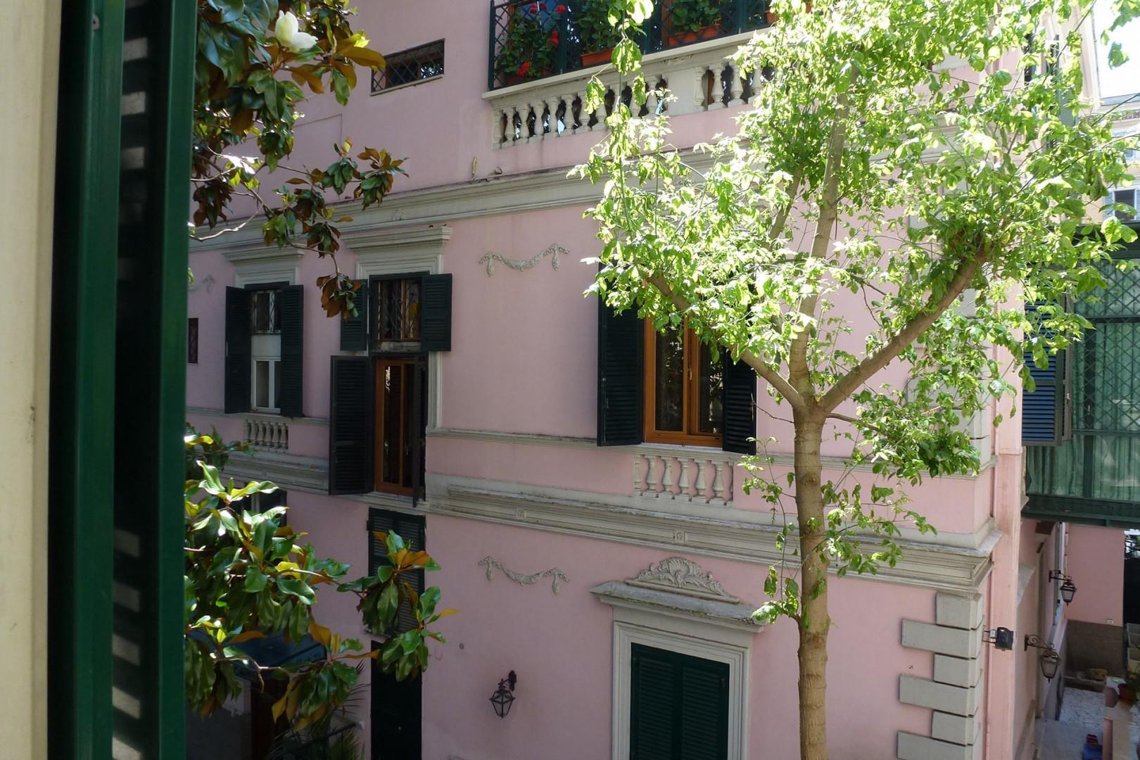 Windows overlook dreamy Art Nouveau neighboring buildings.