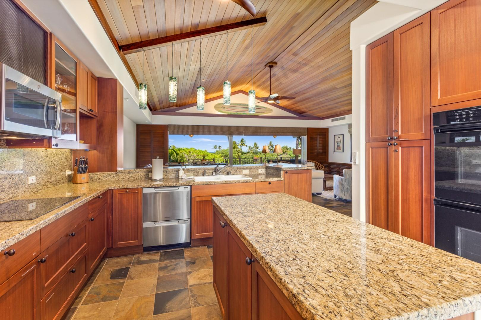 Gleaming top tier appliances, granite countertops and elegant lighting - a chef's delight!