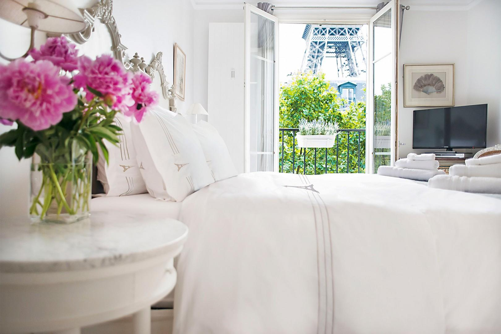 The spacious bedroom 1 has double-glazed French doors.