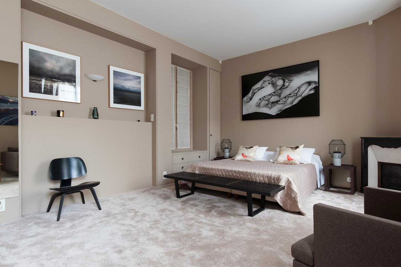 The bedroom exudes luxury and artistic flair.