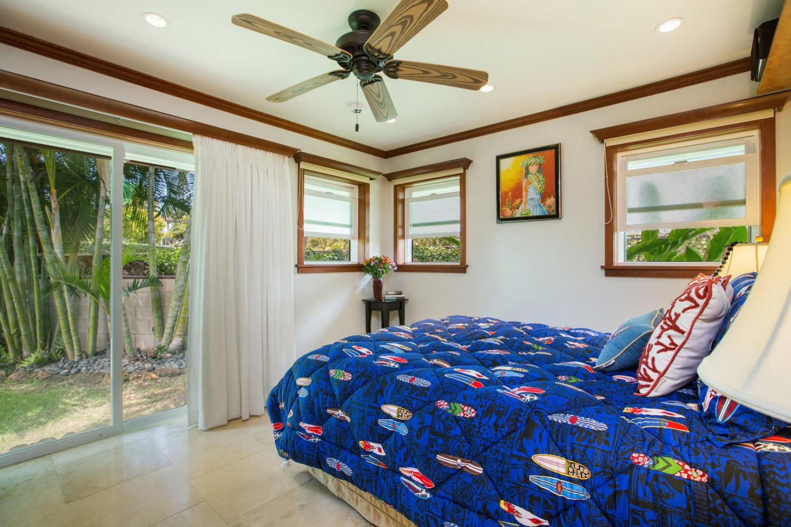 The surf bedroom has yoga lawn views, a sliding door that leads to the pool area, and a cherry wood closet system with drawers.