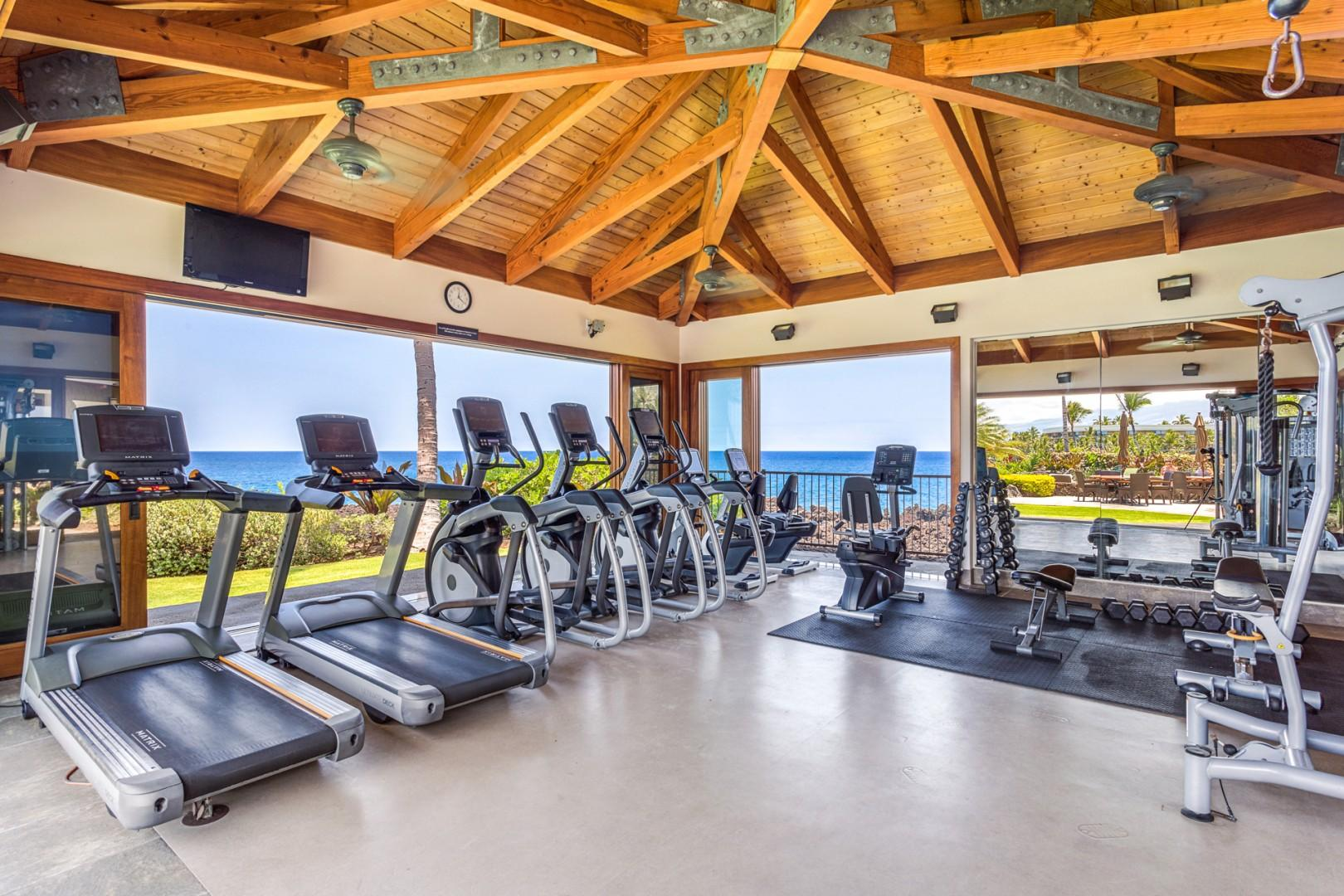 Fitness room interior with multiple and varied cardio and weight machines.