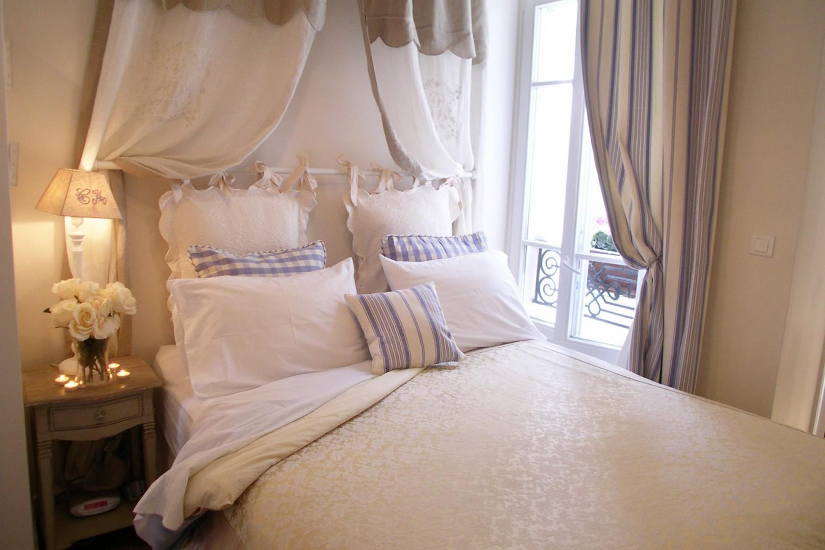 Relax in the beautiful bed with a romantic antique French pelmet.