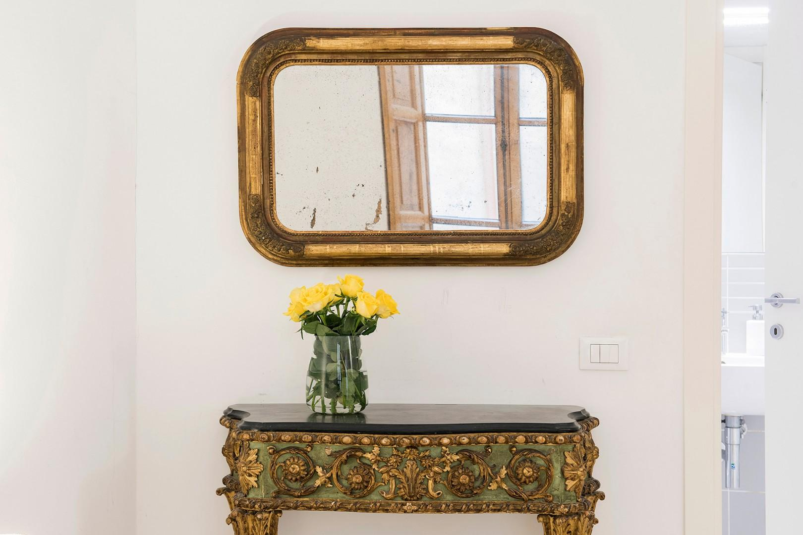 Beautiful antique side table in bedroom 1.