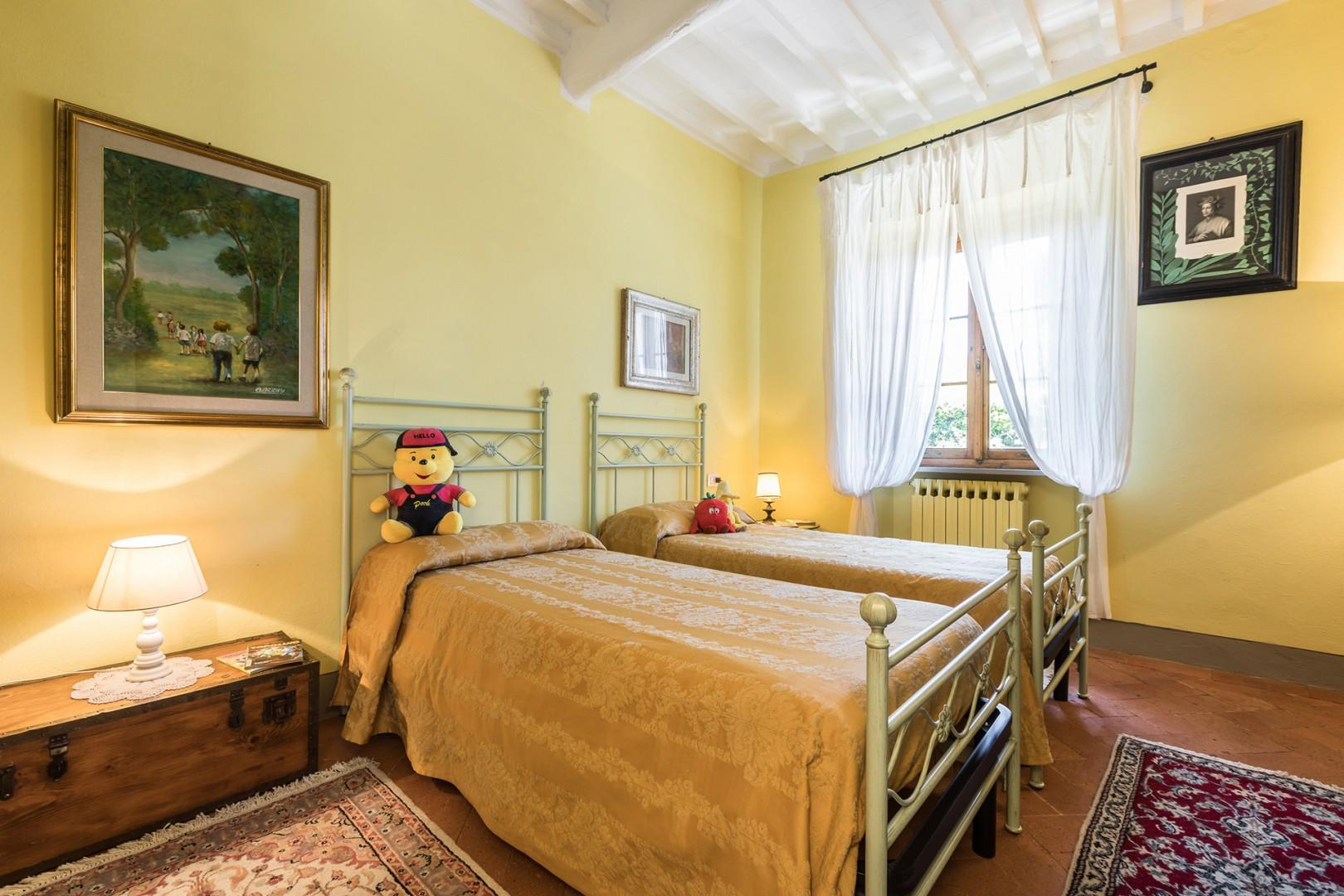 Bedroom 4 with combinable beds and en suite bathroom.