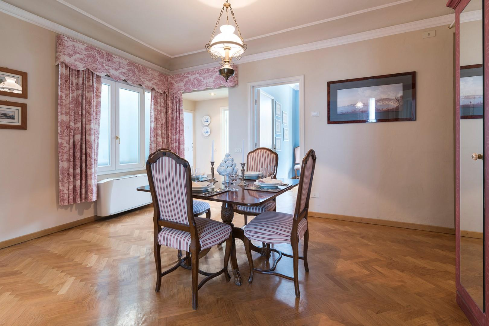 Dining room is at the center of the apartment, with easy access to the living room and kitchen.