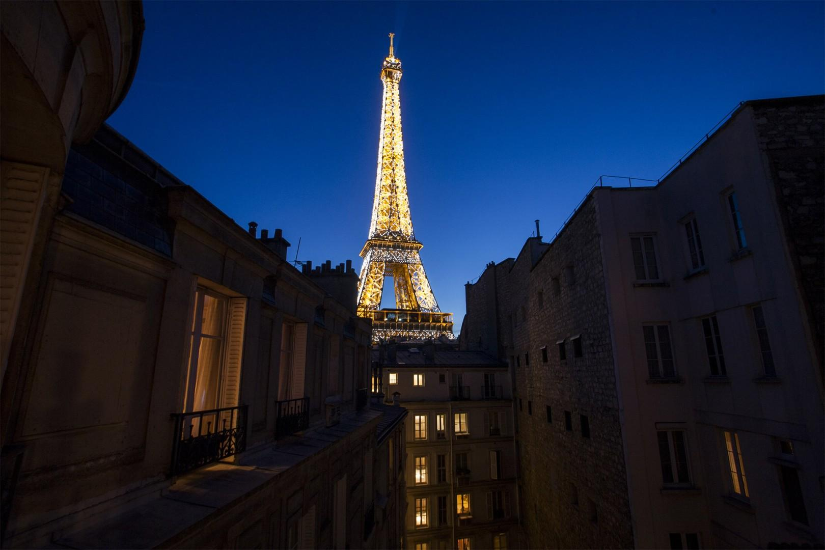 Enjoy the unforgettable view of the Eiffel Tower at night!