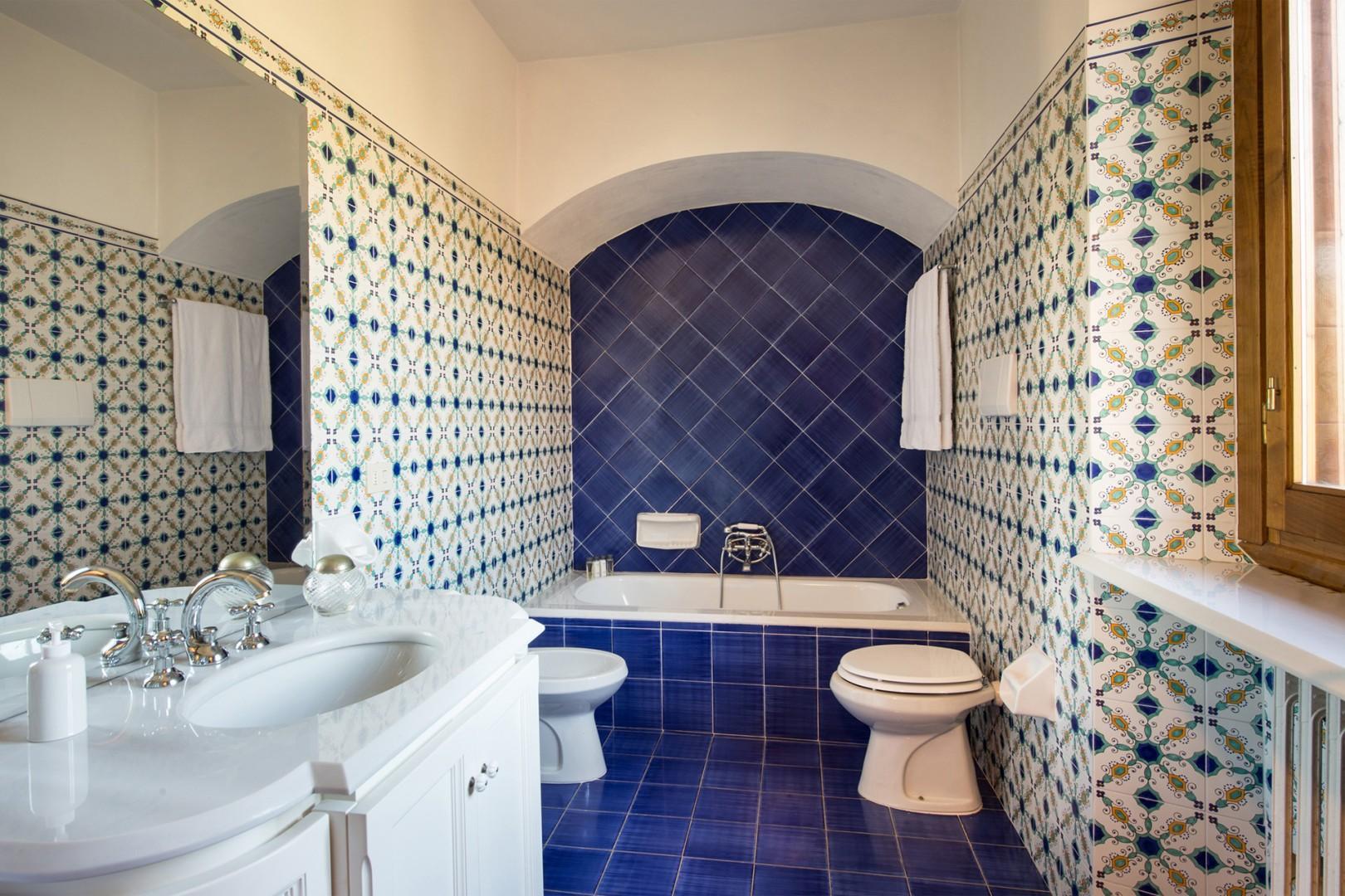Beautiful bathroom 2 with bathtub, sink, toilet and bidet.